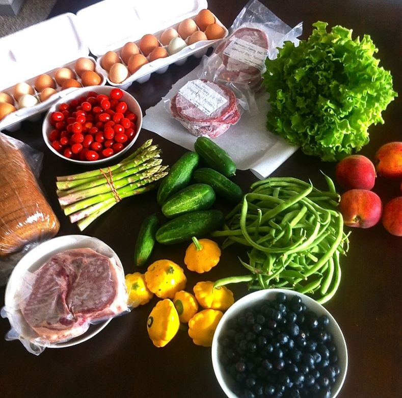 A typical trip to the farmers market. For $80 I purchased two dozen eggs, eight hamburger patties, two pork chops, a loaf of bread, two pints of blueberries, a pint of cherry tomatoes, five peaches, seven cucumbers, a pound of asparagus, a head of lettuce, and generous handfuls of green beans and squash.